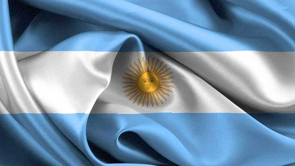 Bandera argentina con el sol de mayo.Veronese Producciones · Publicidad Integral.
